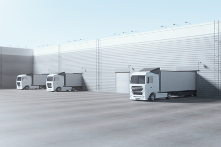 Facade of an industrial building and warehouse with freight cars parked parallelly under bright blue sky. Advertising copy space. Industry concept. 3D Rendering