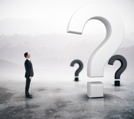 Side view of young adult businessman looking at question marks on abstract foggy gray background. Doubt concept. 3D Rendering 版權商用圖片