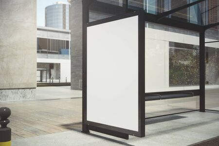 Modern glass bus stop with empty advertising banner on sunlit street. Mock up, 3D Rendering Stock Photo