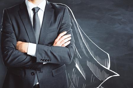 黒板壁の背景に描かれた岬で実業家。保護の概念 写真素材