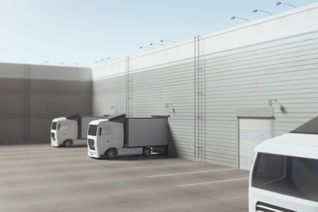 Facade of an industrial building and warehouse with freight cars parked parallelly under bright blue sky. Advertising copy space. Transport container concept. 3D Rendering Imagens