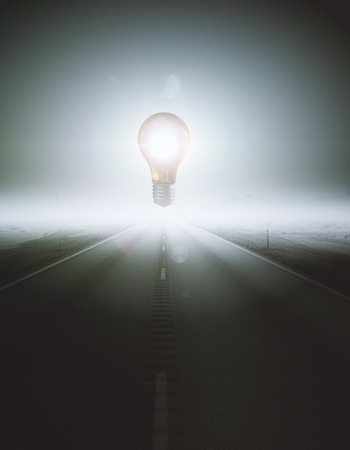 middle: Abstract glowing levitating lamp in the middle of road. Enlightenment concept. 3D Rendering Stock Photo