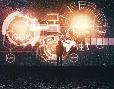 Vue arrière du jeune homme d'affaires en regardant le ciel étoilé avec hologramme abstrait d'affaires. Concept de technologie et d'innovation. Double exposition Banque d'images - 83155777