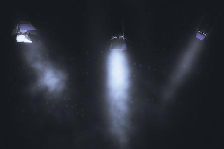Three spotlights on dark smoky backdrop. Professional lighting equipment concept. 3D Rendering