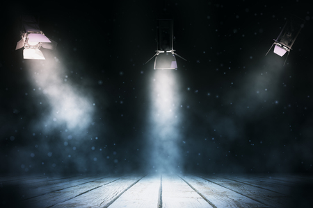 Three spotlights illuminating dark smoky stage with wooden floor. Professional lighting equipment concept. 3D Rendering