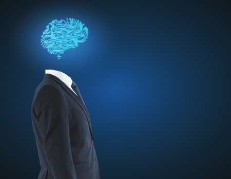 Side view of digital brain headed businessman on blue background. Technology and innovation concept