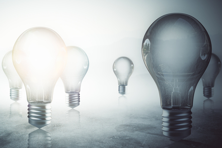 Glowing light bulbs on misty blurry gray background. Solution concept. 3D Rendering