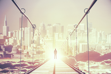 Back view of thoughtful young businessman in the middle of bridge looking at bright city. Success concept. 3D Rendering