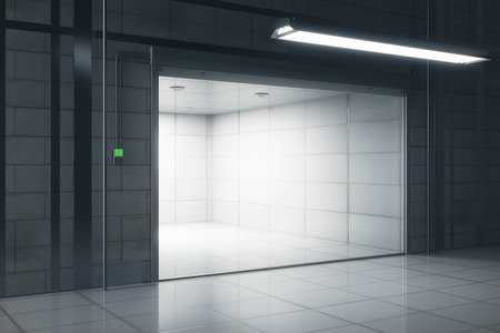Side view of creative tile interior with illuminated opened garage door. Mock up, 3D Rendering Stock Photo