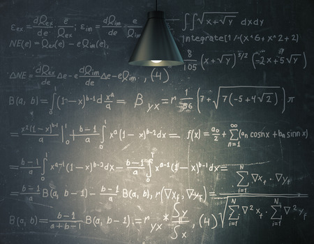 Blackboard with mathematical formulas illuminated with lamp. Education concept