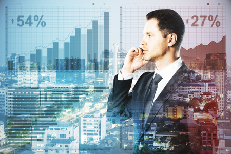 Side portrait of handsome young businessman talking on the phone on abstract city background with forex chart. Analysis concept. Double concept
