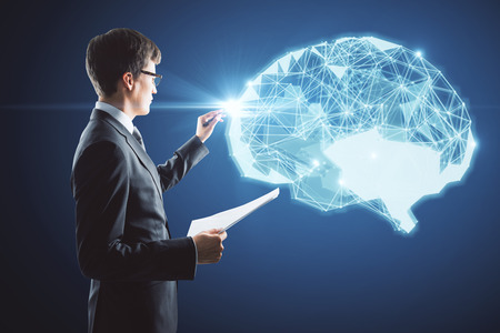 Businessman drawing abstract polygonal brain on blue background. Artificial intellect concept. 3D Rendering Stock Photo