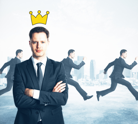 Confident businessman with folded arms and drawn crown. Running people on city background. Leadership concept