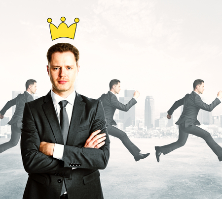 Confident businessman with folded arms and drawn crown. Running people on city background. Executive concept Stock fotó