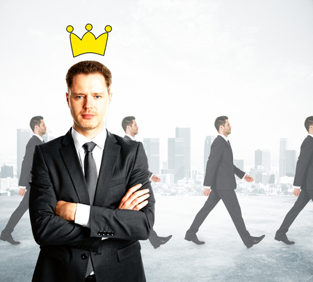 Confident businessman with folded arms and drawn crown. Walking people on city background. Boss concept