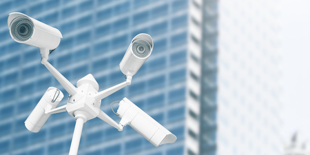 White street cameras with blurry glass building in the background. CCTV concept. 3D Rendering