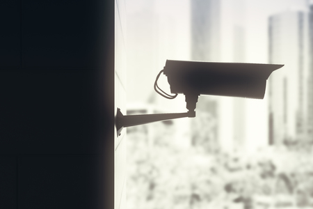 Side view of backlit CCTV camera on blurry city background. System concept. 3D Rendering Stok Fotoğraf