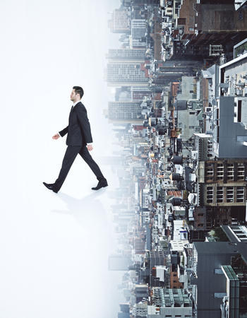 Side view of running businessman on abstract white upside down city background. Forward concept