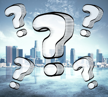 Drawn question marks on city background. Confused concept Stock Photo