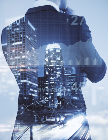 Unrecognizable businessman on abstract city background with business chart. Economy concept. Double exposure
