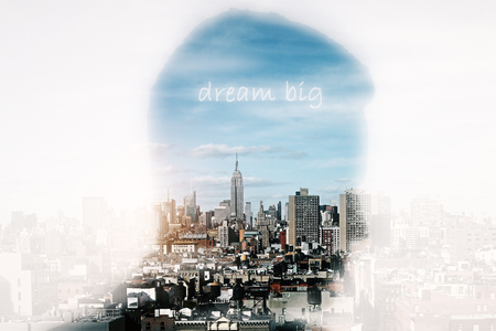 Man head silhouette on bright city background. Dream concept. Double exposure