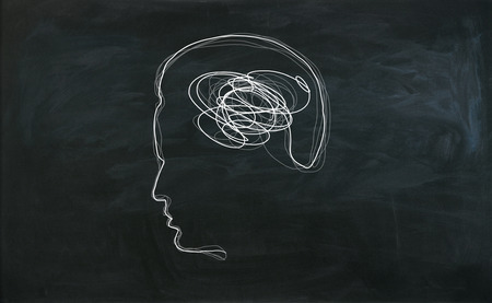 Male head outline with brain scribble