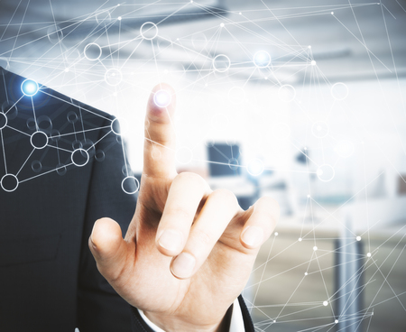 Businessman pointing at abstract polygonal network on blurry office interior background. Connectivity concept. 3D Rendering