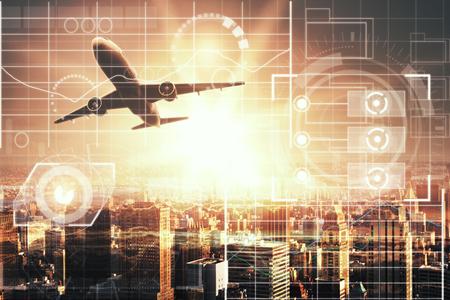 デジタルビジネスチャートのインターフェイスと日光と都市の背景に飛行機。技術の概念。二重露光 写真素材