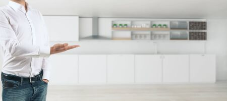 Mans hand presenting showing blurry kitchen interior with counters and equipment. Rent concept. 3D Rendering