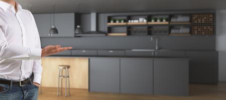 Man hand die tonend vaag keukenbinnenland met tellers en materiaal voorstellen. Eigenaar concept. 3D-weergave