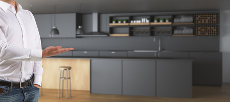 Mans hand presenting showing blurry kitchen interior with counters and equipment. Owner concept. 3D Rendering