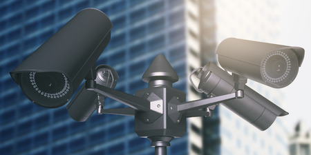 security monitor: Black street cameras with blurry glass building in the background. CCTV concept. 3D Rendering