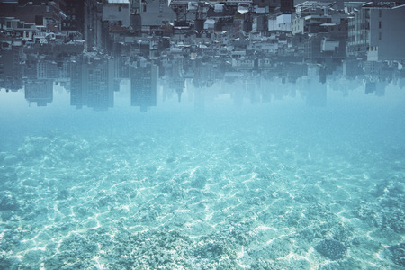 Abstract upside-down city and water, ocean, sea background with copy space. Creativity, abstraction and innovation concept Stock Photo