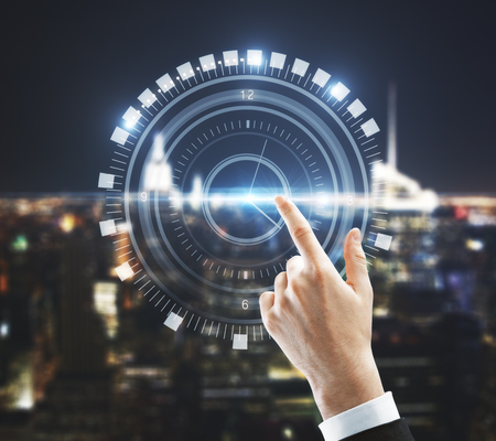 Businessman hand pointing at abstract digital clock on night city background. Technology concept. Double exposure
