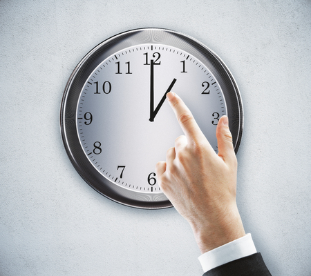 Hand pointing at clock on concrete wall background. Time management concept. 3D Rendering