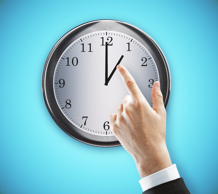 Hand pointing at clock on concrete wall background. Punctual concept. 3D Rendering