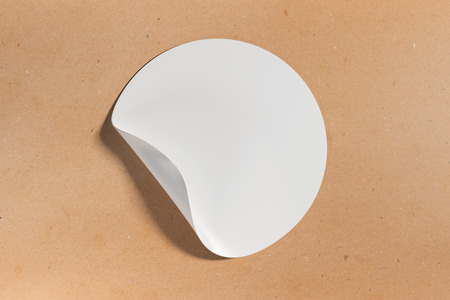 wite: White round sticker with curled peel off corner on light background. Text concept. Mock up, 3D Rendering Stock Photo