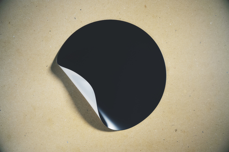 Black round sticker with curled peel off corner on light background. Page concept. Mock up, 3D Rendering