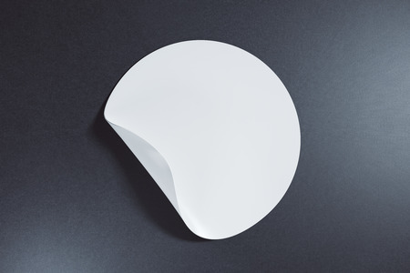 White round sticker with curled peel off corner on dark background. Information concept. Mock up, 3D Rendering