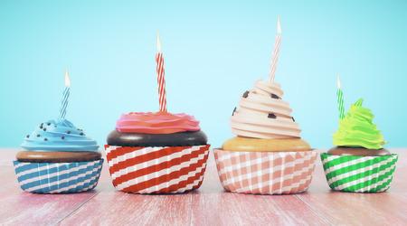 青の背景にキャンドルのカップケーキの品揃え。お祝い、誕生日、食品のコンセプト。3 D レンダリング 写真素材
