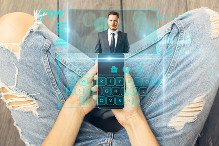 Casual woman hands holding device with business hologram, talking to businessman. Wooden background. Concept of network, communication and innovation