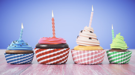 Assortment of cupcakes with candles on blue background. Celebration, birthday, sweets concept. 3D Rendering