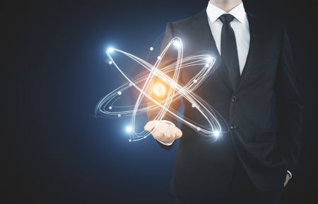 Unrecognizable businessman holding abstract glowing atom. Medical concept Stok Fotoğraf - 87396698