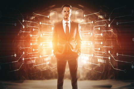 Handsome confident young eurpean businessman standing in abstract interior with glowing circuit board. Innovation concept. 3D Rendering Stock Photo