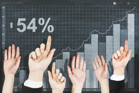 education concept: Row of waving hands on abstract chalkboard background with drawn business chart. Finance concept Stock Photo