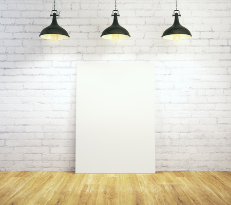 White brick interior with empty poster illuminated with lamps and wooden floor. Gallery, frame, copyspace, exhibition concept. Mock up, 3D Rendering