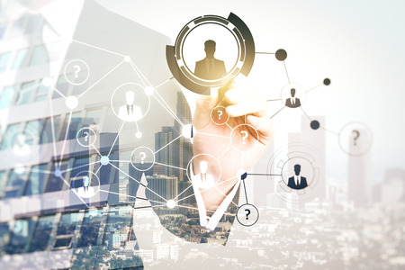 Businessman pointing at abstract digital hr network on city background. Recruitment concept. Double exposure Stock Photo