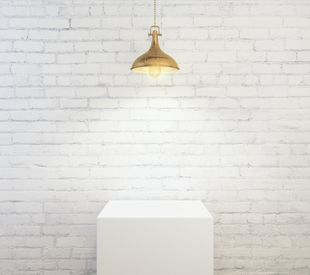 Empty podium on white brick wall background illuminated with lamp. Product concept. Mock up, 3D Rendering Imagens