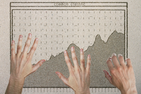 Abstract image of hands with drawn business chart on concrete background. Teamwork and income concept