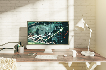 Creative office desktop with forex chart on computer screen, coffee cup and other items. Brick wall background. Investment concept. 3D Rendering Stock Photo